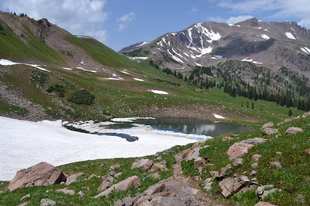 ice covered lake with Red Buffalo Pass in the background
