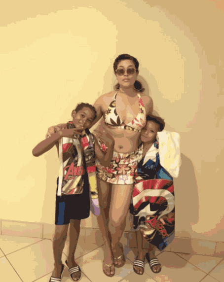 Adunni Ade shows off sexy bikini body as she hits the pool with her sons