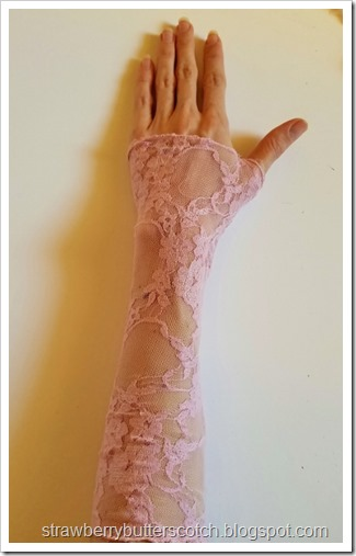 One of the lace finger less gloves worn.  It just a tube of fabric, hemmed on the ends and fitted to a human arm.