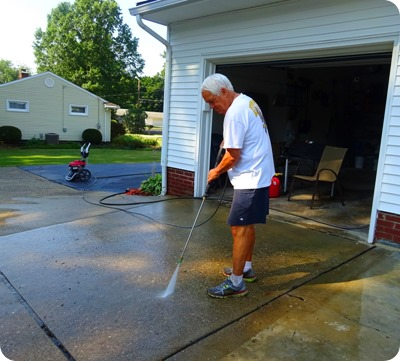 Paul using pressure washer