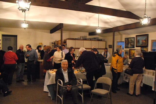 Guests enjoy fellowship and refreshments.
