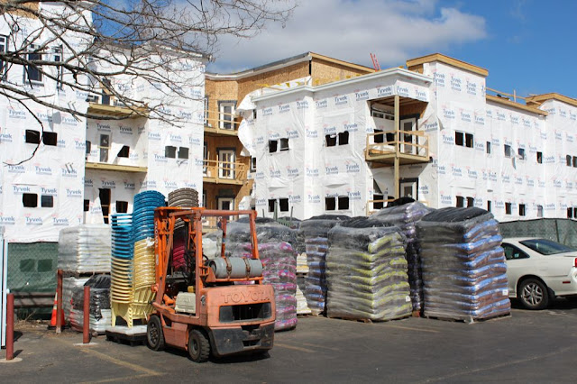stacks of mulch in the foreground, Tyvek HomeWrap in the background