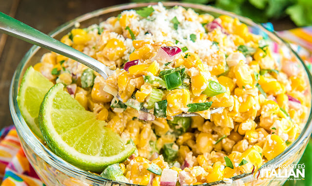 Mexican Street Corn Salad with a spoon in the bowl