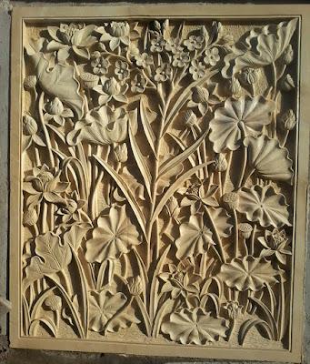Relief bunga tulip dan lotus batu alam paras jogja