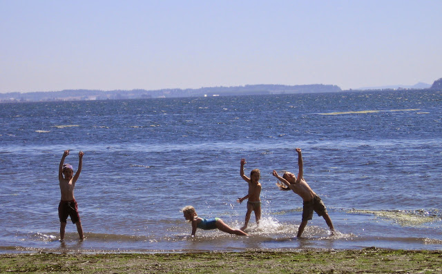 Children have a grand time splashing in the cool water of Bellingham Bay / Credit: Aimee Frazier