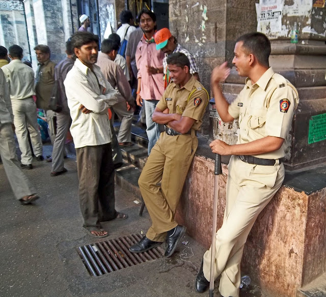 policemen outside VT railway station