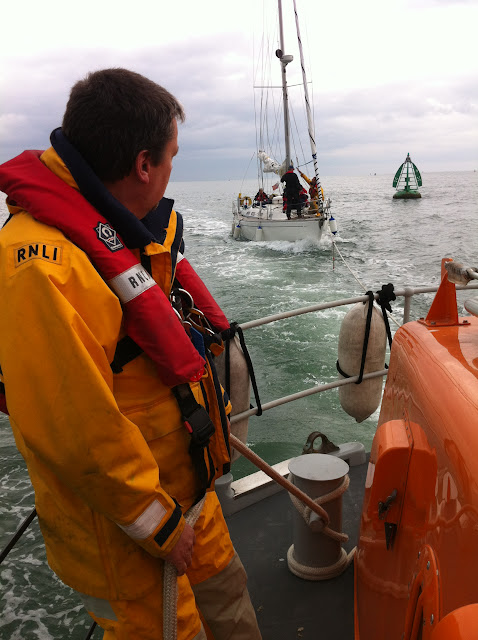 8 April 2012: Crew member onboard the Tyne class lifeboat monitoring the tow of the yacht back into Poole Harbour. Photo: RNLI Poole Dave Riley