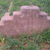 Graveyard in Mochudi, a hand carved gravestone