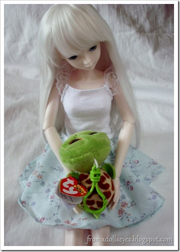 Ball Jointed Doll Making Friends with a Plush Turtle