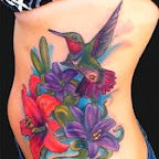 lilies and hummingbird - Tattoo art - Rib Side Tattoos Designs