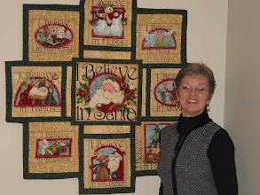 "Photo: Using HBH 202 Wetland Wonders, Trisha made this wall hanging from this ""I Believe"" panel by Art to Heart. The panel was cut up, fabric added to make 10"" squares with a larger square in the middle. It was entered in a Panel Challenge at The Art of Fabric in Pickering, ON fall 2009 where it won a first prize."
