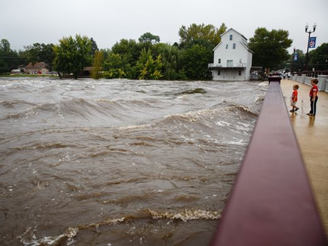 Flood waters lap at the top of the Cherry Street bridge in Shell Rock, Iowa, on Friday, 23 September 2016. Photo: Brian Powers / Des Moines Register