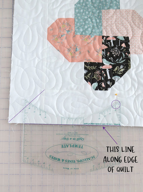 How to use the Scallops, Vines and Waves template from Quilt In A Day - A Bright Corner shows how to use the ruler to make a scalloped edge on a quilt