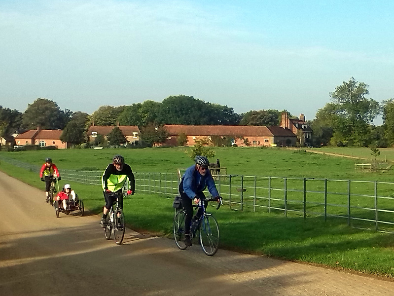 cyclists in parkland