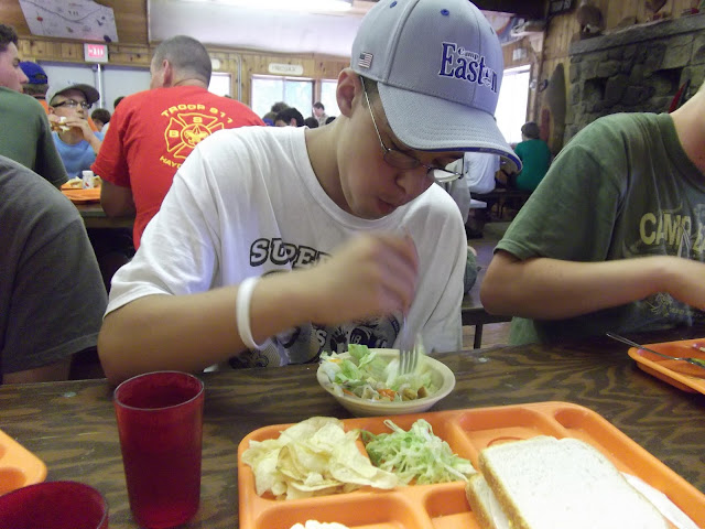 Matthew demonstrating that scouts do eat salads