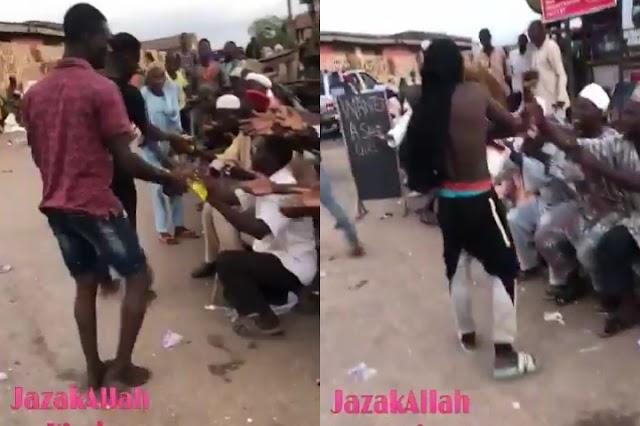 Hoodlums Begun Sharing Looted Palliatives To Beggars (Video)