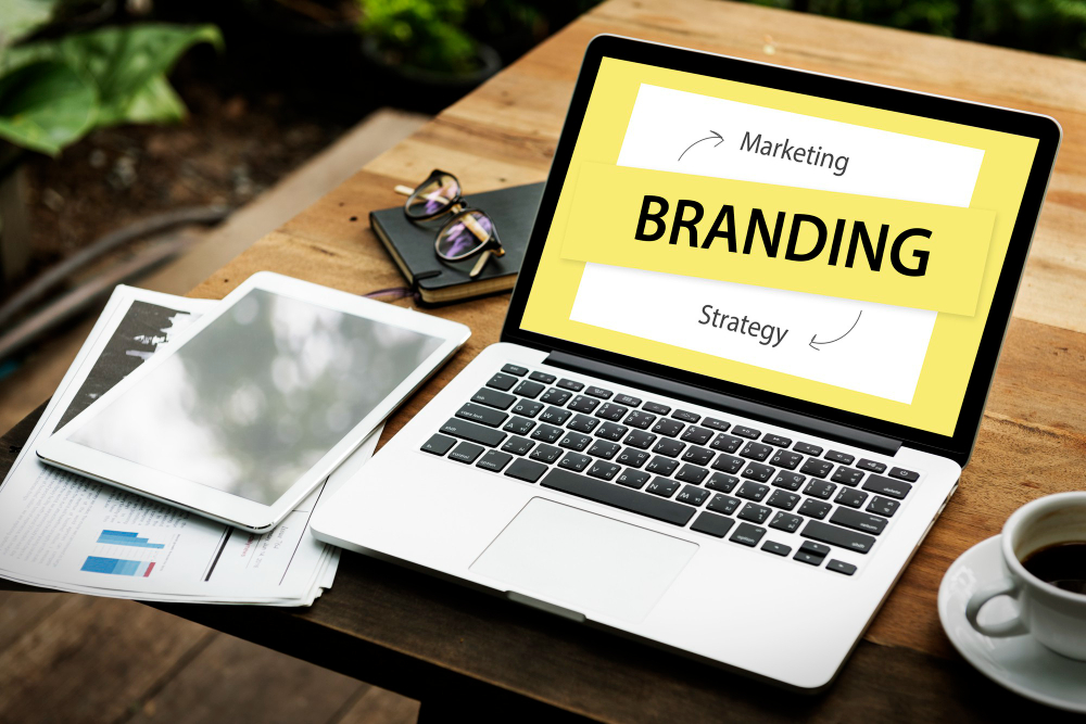 laptop with words marketing, branding and strategy