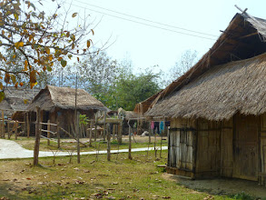 Photo: The village is made up of two smaller villages. The Laotians of the Mekong river and some Hmong from the highlands lived next to each other.  This shows a Hmong community.