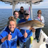 Captain Dwayne holding  Miss Tayor Big Bull Redfish 11-20-2018