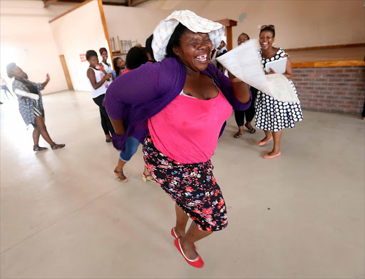 Elizabeth Tyongwana celebrates her daughter's results after a bumper number of pupils wrote matric.