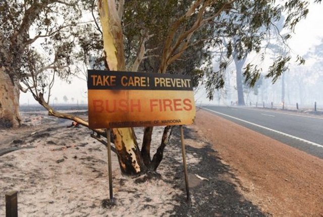 A handout photo taken on 7 January 2016 shows damage from a fire near Waroona in Western Australia. The out-of-control blaze 110 kilometres south of Perth more than doubled in size in 24 hours and burned through 130,000 acres, with a third of the town of Yarloop destroyed. Photo: Australia Fire and Emergency Services