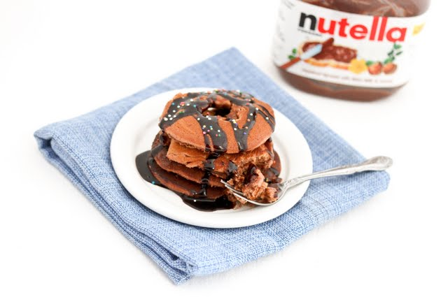 photo of Nutella Donut Pancakes on a plate with a fork