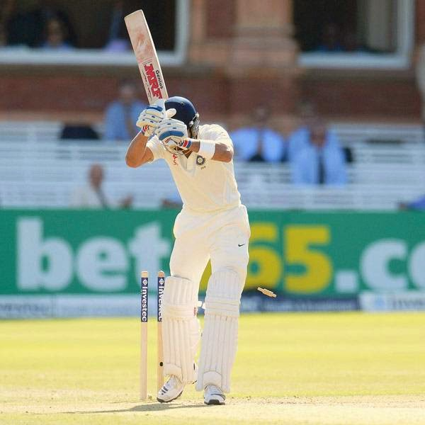 India's Virat Kohli is bowled by England's Liam Plunkett (not pictured) during the second cricket test match at Lord's cricket ground in London July 19, 2014.