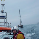 ILB crew member sat at the rear of the ILB during the yacht tow - 23 August 2013.  Photo credit: RNLI/Poole