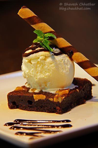 Close-up of Warm Brownie with Chocolate Sauce at Frisco, Koregaon Park, Pune