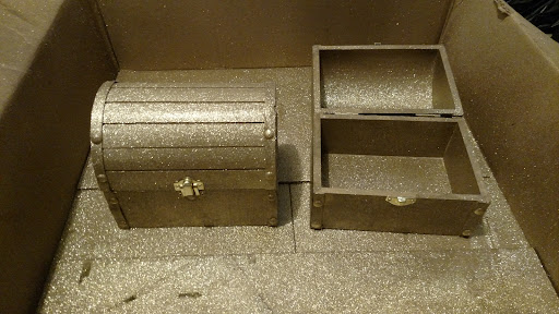Once the polyurethane is completely dry, screw back on the hinges and clasp.