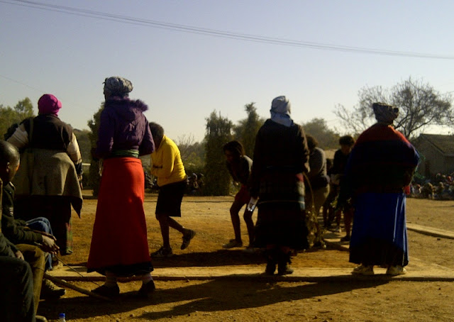 Bojale initiates coming from the crall entering the Kgotla