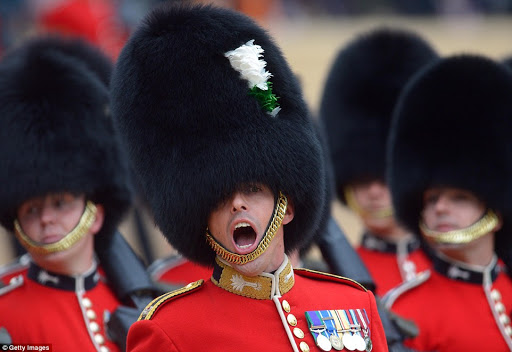 Members of the Welsh Guards march past the Queen while taking part in the Trooping of the Colour parade in London earlier today.jpg