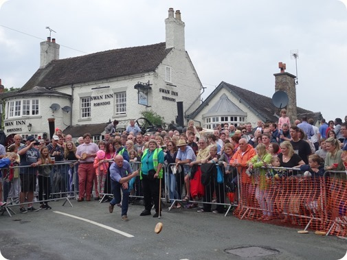 A competitor in the Adult race rolls outside the Swan  Inn