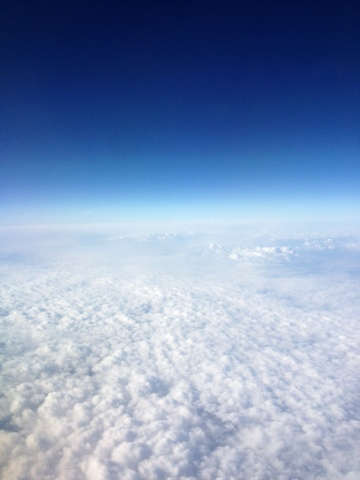 Picture of intense blue sky and white cotton like clouds.