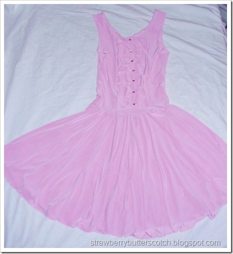 Cute pink knit dress with a circle skirt and rhinestones.