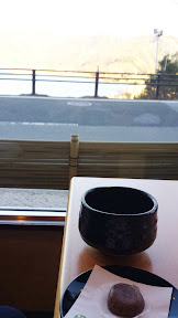 At our ryokan Wakakusa no Yado Maruei, after checking in at the front desk they took us to a room that seemed like an empty cafe with tables and chairs, and sat us at a table with a view of Lake Kawaguchiko to welcome us with tea and a tea snack
