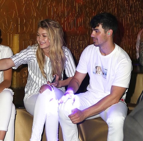 gigi-hadid-joe-jonas-1-vogue-23july15-splash-exc_b_592x888