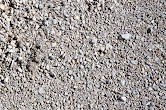 """1/4"""" Minus - Crushed rock mixed with dirt and sand that packs down very well. Used for walkways or pathways and also works as a great products under paving stones."""