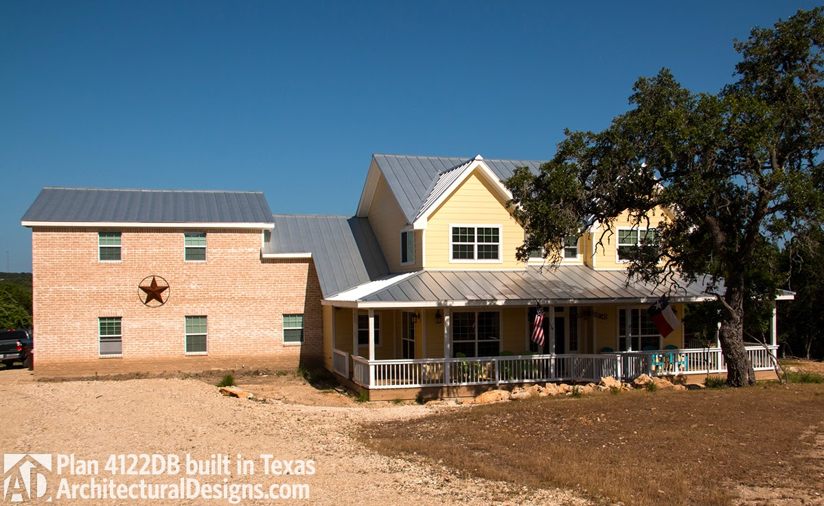 house plan 4122db comes to life in texas with an expanded garage