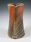 Lg. Altered Vase form with hasp cut sides