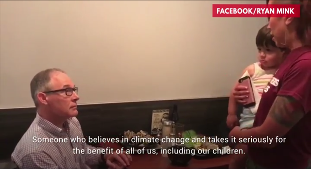 Screenshot from a video showing teacher Kristin Mink xconfronting EPA Administrator Scott Pruitt in a Washington, D.C. restaurant on 2 July 2018. She told Pruitt, 'We deserve to have someone at the EPA who actually does protect our environment; someone who actually does believe in climate change and actually takes it seriously for the benefit of all of us, including our children.' Photo: Kristin Mink