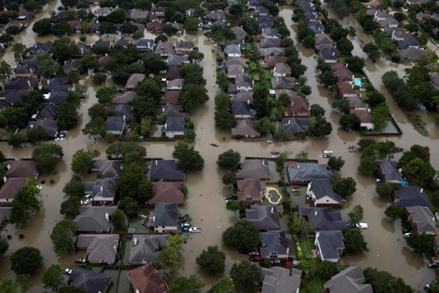 Aerial view of houses in Northwest Houston submerged in floodwaters from Hurricane Harvey. Photo: Adrees Latif / REUTERS