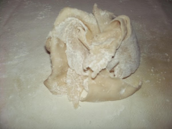 You'll have scrap dough left so ball it back up and knead it just...