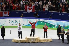 Charles Hamelin on the gold medal podium