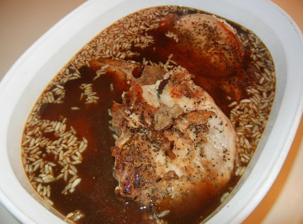 Pour undilated beef consomme' and skillet drippings over pork chops and rice.