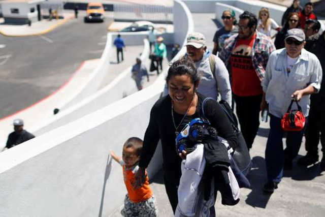 Members of a caravan of migrants from Central America enter the United States border and customs facility, where they applied for asylum, in Tijuana, Mexico on 3 May 2018. Photo: Edgard Garrido / Reuters