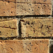 Water will bead up on the brick and mortar surfaces. There is no change of color, sheen or texture of the brick coated with A-Tech Masonry and Brick Sealer siloxane water repellent.