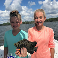 Abbie and Samantha with a small triple tail  10-06-2018