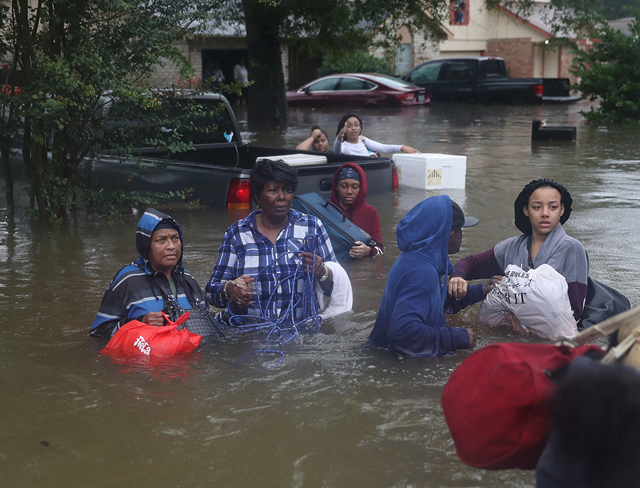 People evacuate their flooded homes on Monday, 28 August 2017, in Houston, after Hurricane Harvey flooded the city. Photo: Joe Raedle / Getty Images