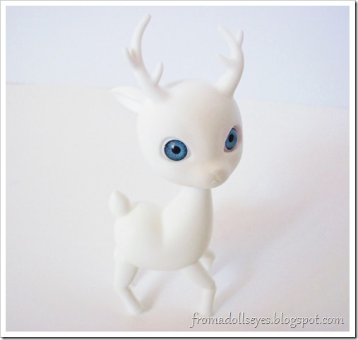 A ball jointed deer chasing it's tail.  Cute! (bjd pics)